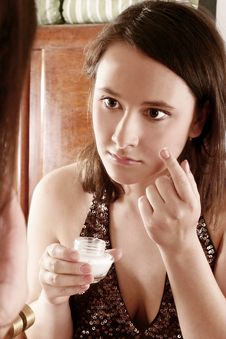Free Woman Putting Cream In Front Of  A Mirror Stock Photo - 1364500