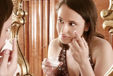 Free Woman Putting Cream In Front Of  A Mirror Stock Images - 1364554