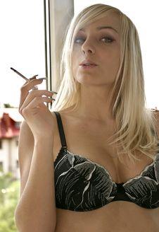 Woman In A Bra Smoking Stock Image