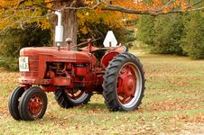 Antique Tractor In Rural Setting Royalty Free Stock Photos