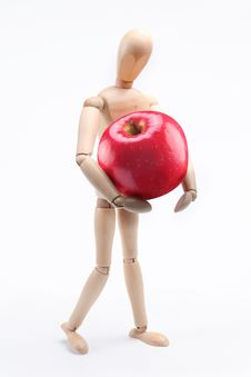 Free Wooden Man Holding A Large Red Apple Royalty Free Stock Image - 13600506