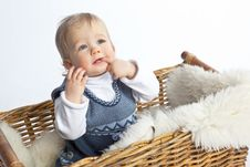 Free Cute Baby Sitting In Wicker Basket Royalty Free Stock Photo - 13601035