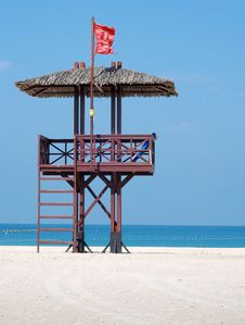 Free Red Flag On A Beach Stock Images - 13602134