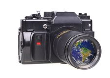 Old SLR Camera. In A Lens The Globe Is Reflected Stock Images