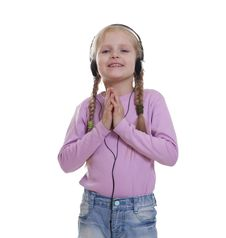 The Smile Little Girl In Headphones Stock Photography