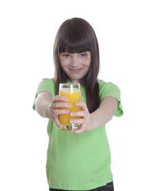 The Smile Little Girl With Orange Juice Stock Photo