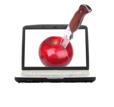 Free Knife Cutting An Apple On The Screen Laptop Stock Photos - 13602763