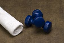 Blue Dumbbells And A White Towel Royalty Free Stock Photo