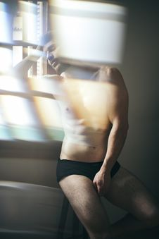 Free Photo Of Topless Man Leaning Near Window Stock Image - 136045531