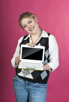 Blond Young Woman With Laptop Royalty Free Stock Photos