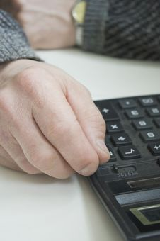 Workman`s Hands And A Calculator. Stock Photography