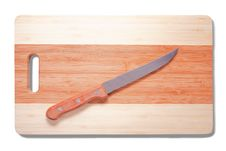 Knife Over Cutting Board Royalty Free Stock Image