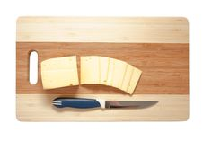 Cheese On An Wooden Cutting Board Stock Images