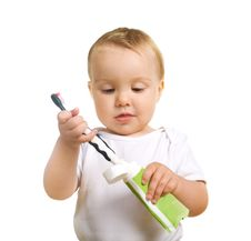 Serious Kiddy With A Tooth Brush Royalty Free Stock Images