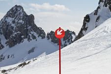 Down Arrow Sign On Ski Slope Stock Photography