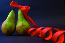 Free Two Pears One In A Red Gift Tape Stock Image - 13616551