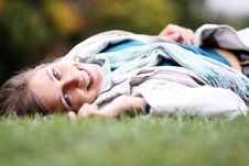 Woman Relaxing In The Grass Stock Photo