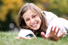 Free Woman Relaxing In The Grass Stock Photos - 13618983