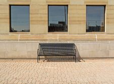 Free Solitary Bench Under Three Windows Royalty Free Stock Image - 13619826