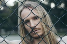 Free Close-up Portrait Photo Of Man Behind Chain Link Fence Royalty Free Stock Photo - 136157095