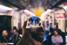 Free Person Holding Clear Glass Ball Royalty Free Stock Image - 136157246