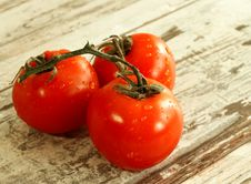 Free Tomatoes With Water Drops On Wooden Stock Images - 13622384