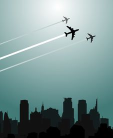 Planes Flying Over The City Royalty Free Stock Photography