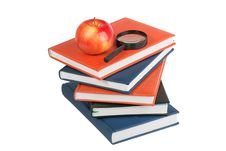 Ripe Apple And Magnifying Glass On Stack Of Books Royalty Free Stock Photo