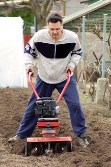 Free Man Rototilling Garden. Royalty Free Stock Photo - 13623205