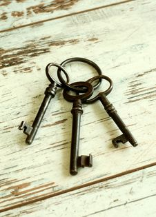 Old Rusty Keys On Wooden Boards Stock Photo