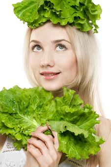 Girl With Lettuce Royalty Free Stock Images