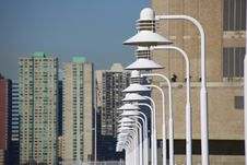 Free Light Poles Over City Skyline Royalty Free Stock Images - 13625459