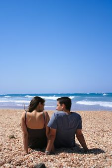 Free Couple Sitting On The Beach Stock Images - 13627484