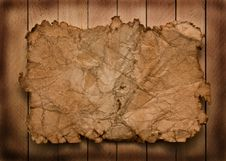 Free Old Paper On A Wooden Background Royalty Free Stock Images - 13627559