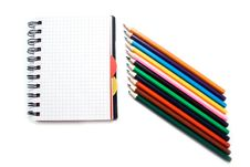 Notebook With A Spring And Pencils Stock Photography