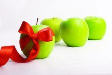 Free The Green Apple Is Decorated Red By A Tape Royalty Free Stock Image - 13628376