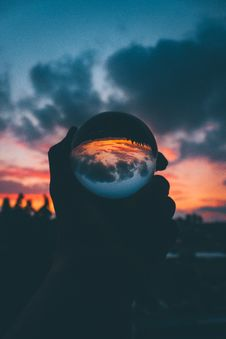 Free Person Holding Lensball During Golden Hour Stock Photography - 136260412