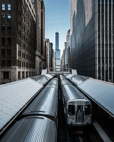 Free View Of Trains Between Highrise Buildings Stock Photos - 136260733