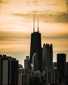 Free Sunset Over City Buildings Stock Image - 136260831