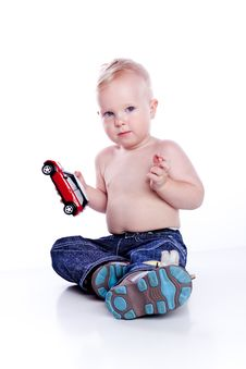 Free Baby Boy Playing With Car Toy Royalty Free Stock Images - 13630439