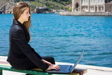 Free Woman With Laptop Near The  Sea Stock Photo - 13631260