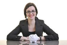 Business Woman Putting Money Coins In Piggy Bank Stock Photos