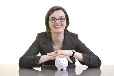 Business Woman Putting Money Coins In Piggy Bank Royalty Free Stock Photos