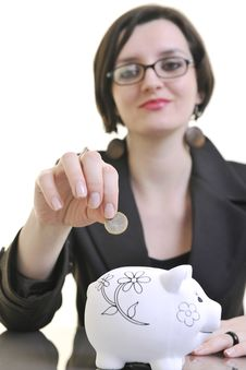 Business Woman Putting Money Coins In Piggy Bank Stock Images