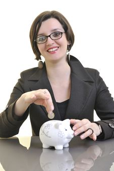 Business Woman Putting Money Coins In Piggy Bank Royalty Free Stock Photo