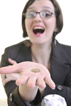 Business Woman Putting Money Coins In Piggy Bank Royalty Free Stock Image