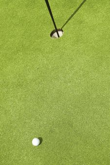 Free Golfing. Ball And The Hole. Stock Images - 13638014