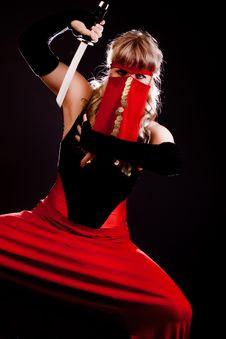 Woman Holding A Katana Stock Images