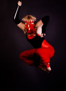 Woman Jumping With Dagger Royalty Free Stock Images