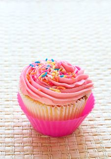 Vanilla Cupcake With Strawberry Icing Stock Photo